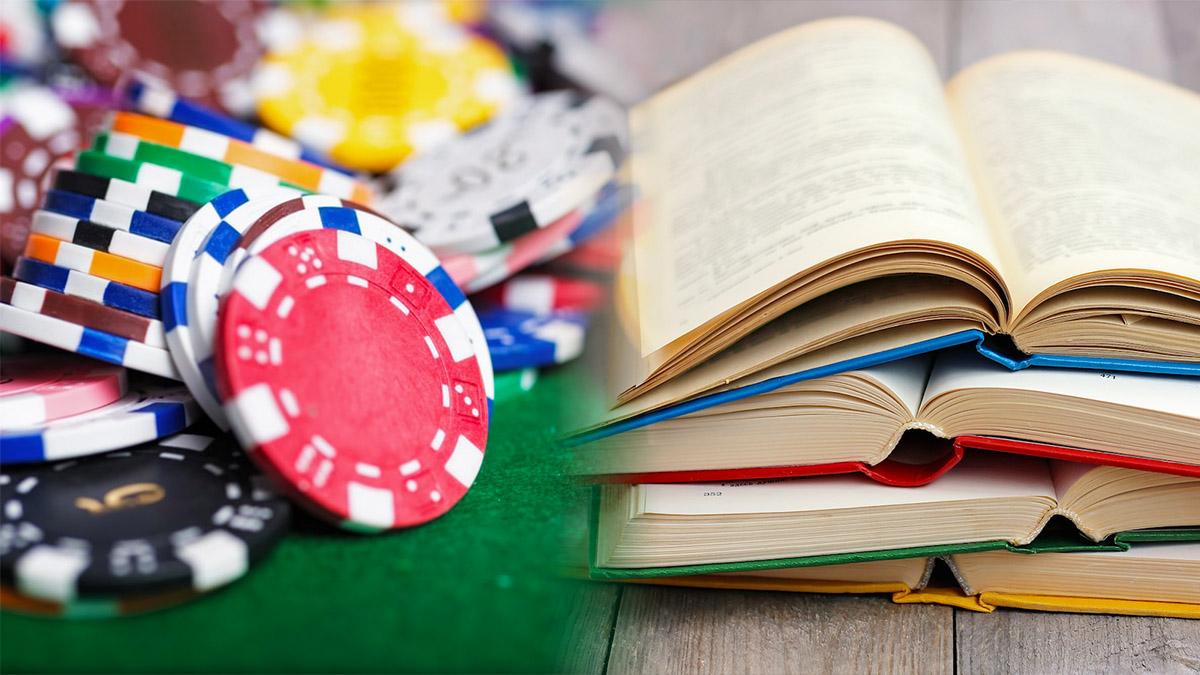man reading book about gambling